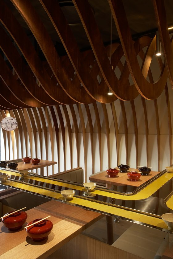 cave restaurant sushi train by koichi takada architects