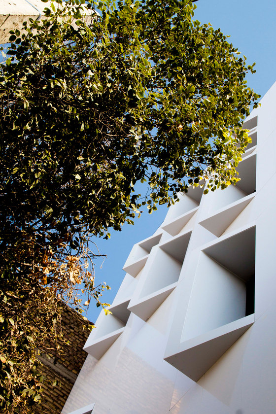 A Beveled Building by Ayeneh Office | Apartment blocks