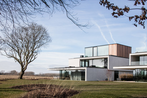 Triplet Villa by Govaert & Vanhoutte Architects | Detached houses