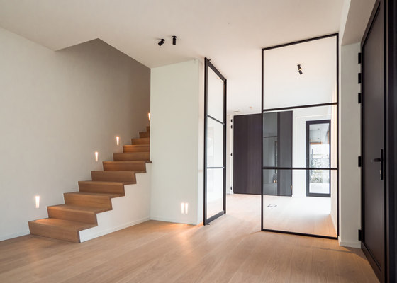 Steel look pivot doors and fixed partitions by PortaPivot reference projects | Manufacturer references