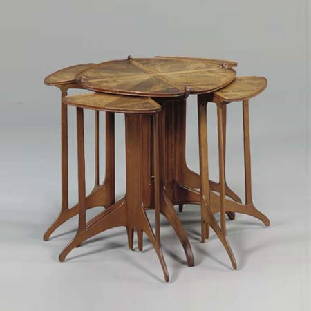 Nest of five rosewood tables