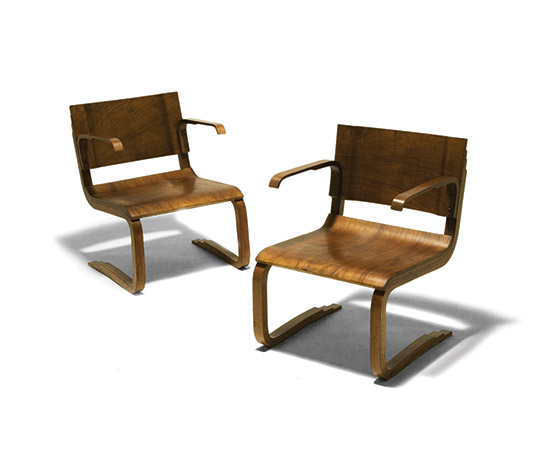 Pair of bent laminated wood chairs by Della Rocca