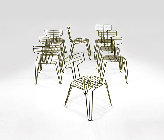 Eight nickel-plated metal chairs