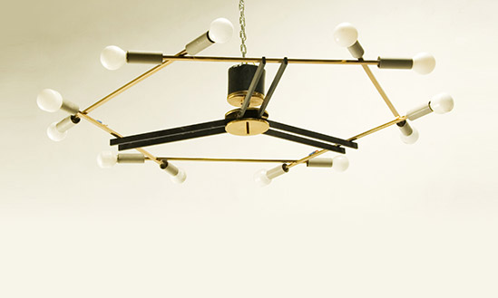 Pair of brass and black metal chandeliers