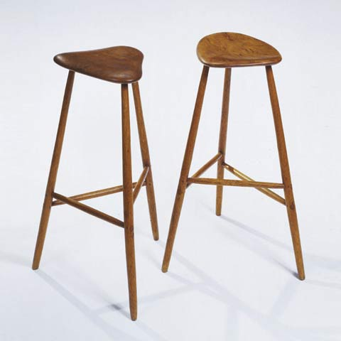 Three legged high stools by Phillips