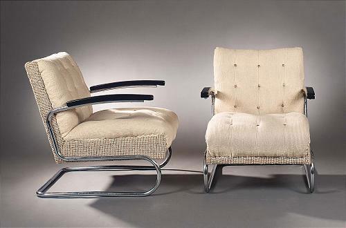 Pair of K 411 tubular steel armchairs