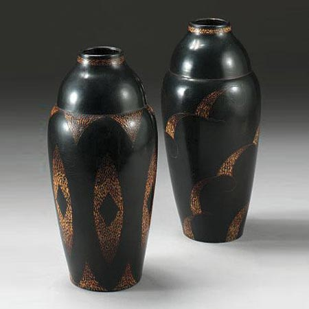 Two blackened metal vases