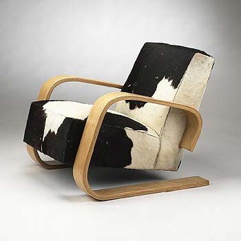 Tank cantilevered armchair