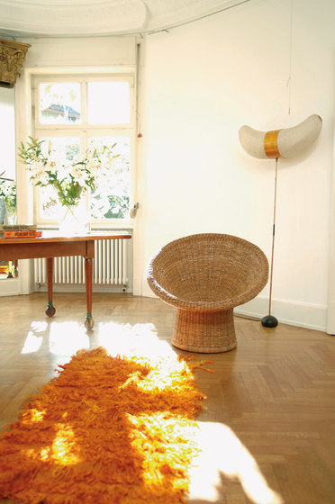 E 10 rattan lounge chair di Richard Lampert