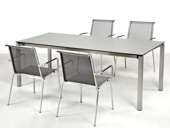 Modena front slide extension table by Fischer Möbel