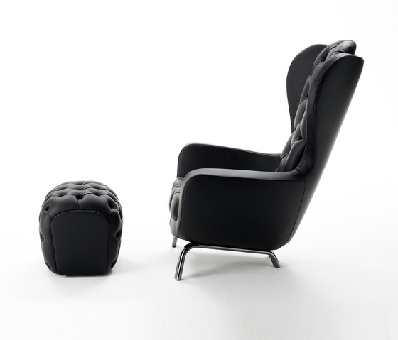 Guelfo wingback & footstool by Opinion Ciatti