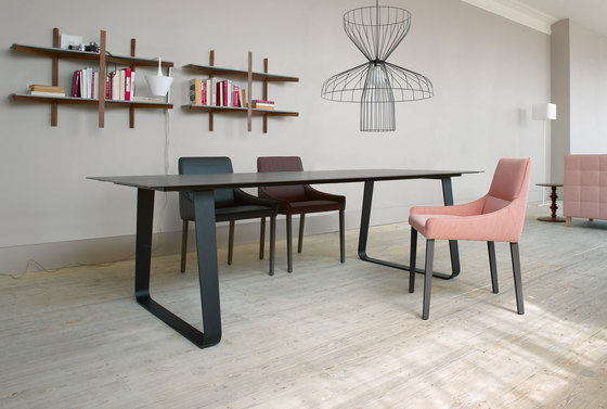 Vilna | Dining Table With Integral Extension Black Lacquered Base by Ligne Roset