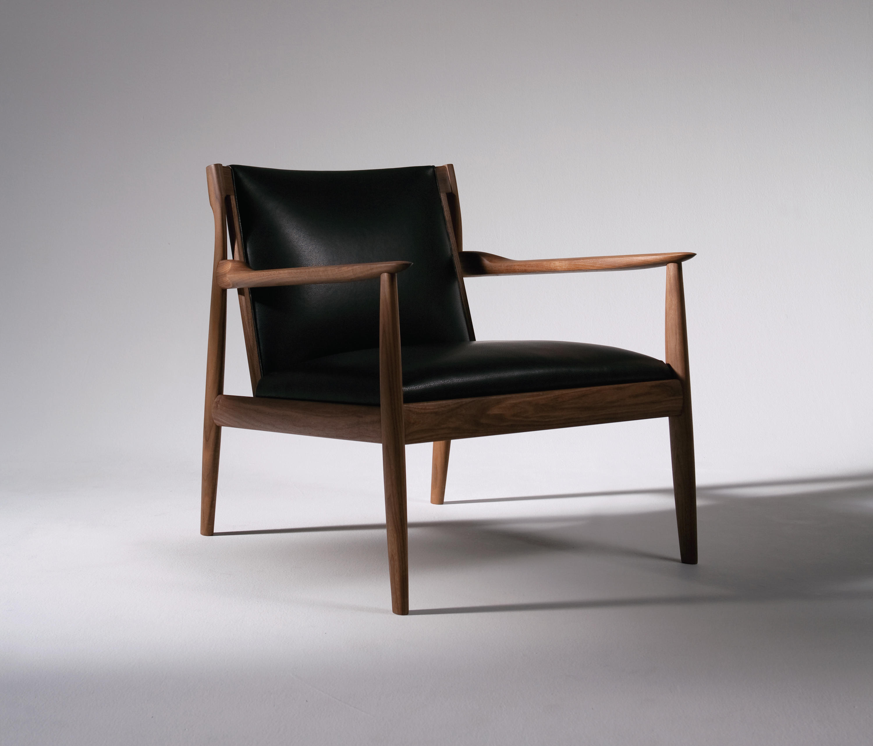 Claude easy chair lounge chairs from ritzwell architonic for Armchair furniture