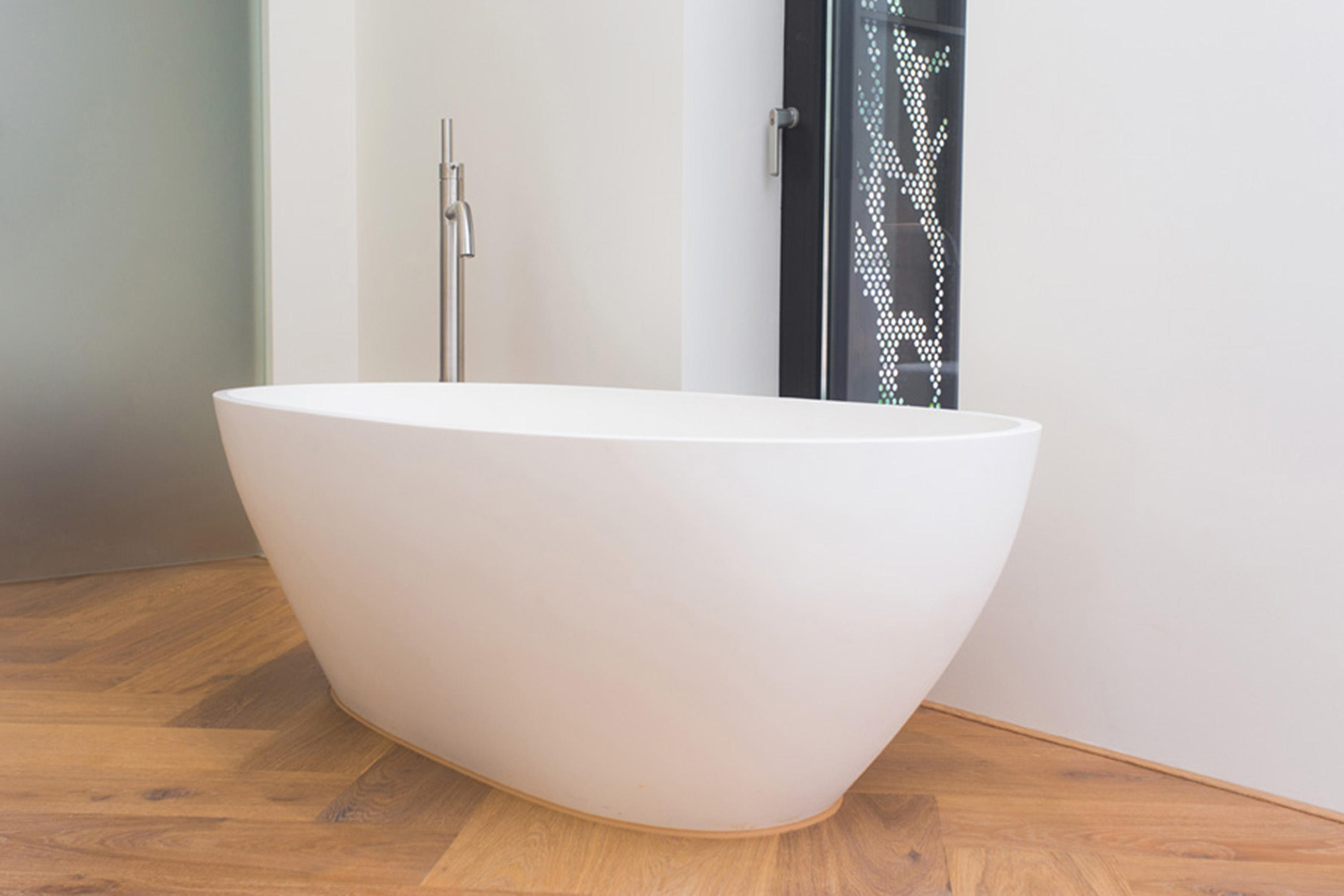 simple structure this purescape in web large aquatica standing bathrooms of the to be free refined s elegant bathtub allows yet solid wht contemporary bath used easily tulip both freestanding aquastone and products shape tub surface