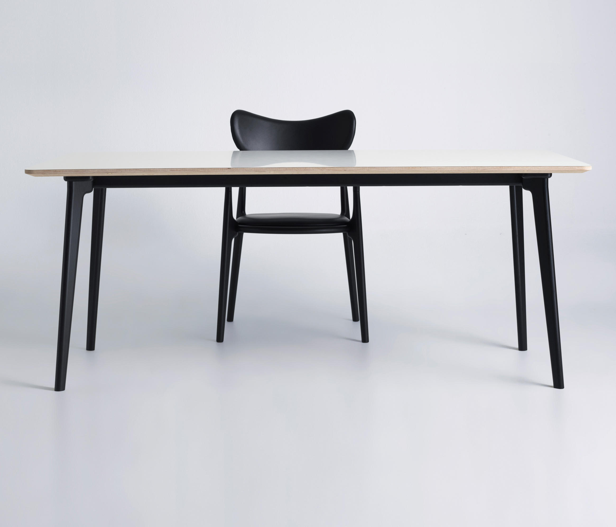 Salon extension table dining tables from true north for Table salon design