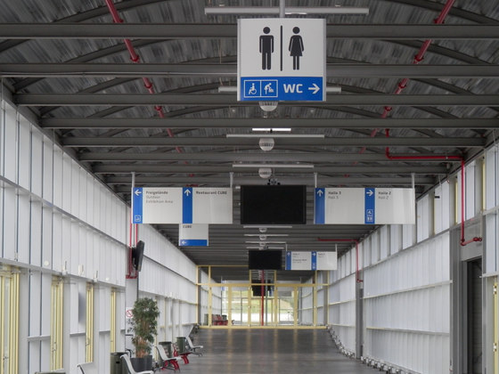 system seven Direction signs ceiling suspended by Meng Informationstechnik   Symbols / Signs