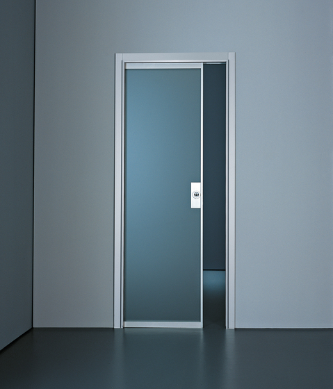 Planus sliding inside the wall by TRE-P & TRE-Più   Internal doors