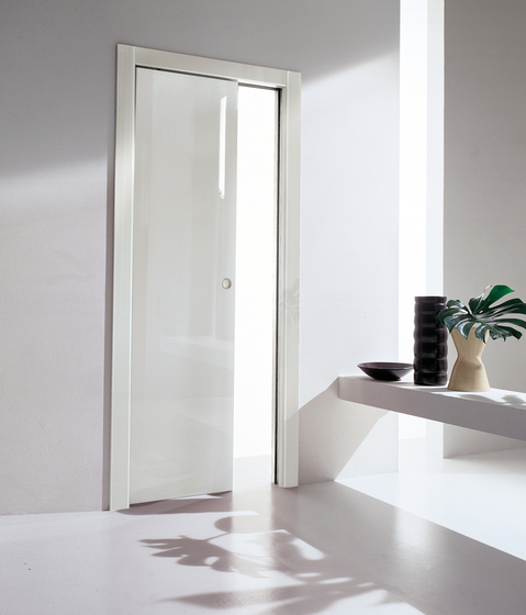 Rever sliding inside the wall by TRE-P & TRE-Più   Internal doors