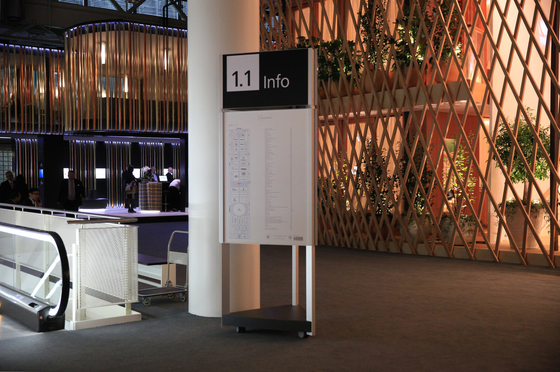 Signage System Messe Basel by BURRI - Mobile indoor F4 triangular stele by BURRI | Media displays