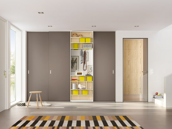 Wooden door sliding door system by raumplus | Space dividing storage