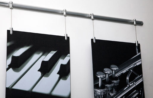 Hanging Wire Panels on Wall Track by Gyford StandOff Systems®   Sign holders