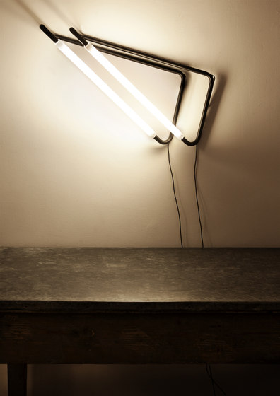 Light Object 001 hang from the wall | black finish by Naama Hofman | Wall lights
