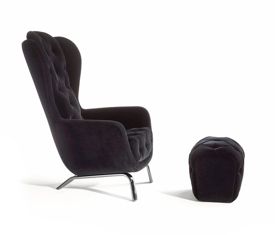 Guelfo velvet wingback & footstool by Opinion Ciatti | Armchairs