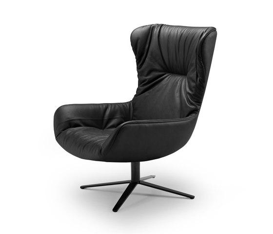 Leya | Wingback Chair with x-base frame by Freifrau Sitzmöbelmanufaktur | Armchairs