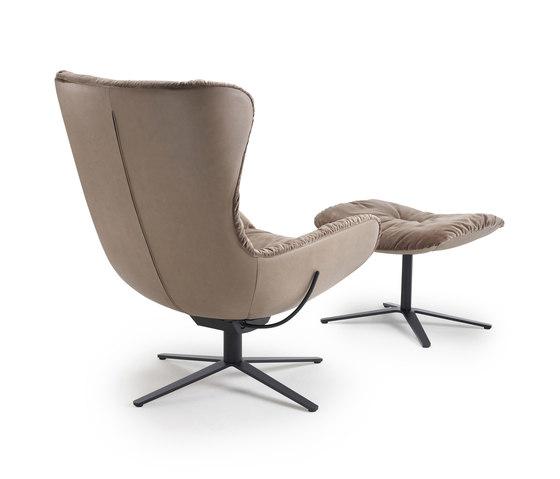 Leya | Wingback Chair with x-base frame with rocker / tilting mechanism & Ottoman by FREIFRAU MANUFAKTUR | Armchairs