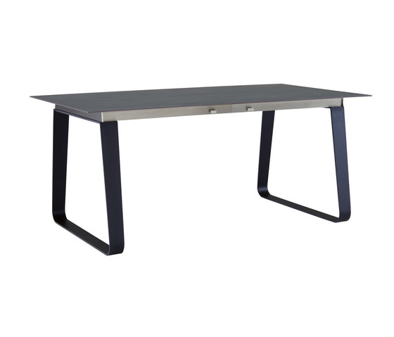 Vilna | Dining Table With Integral Extension Black Lacquered Base by Ligne Roset | Dining tables