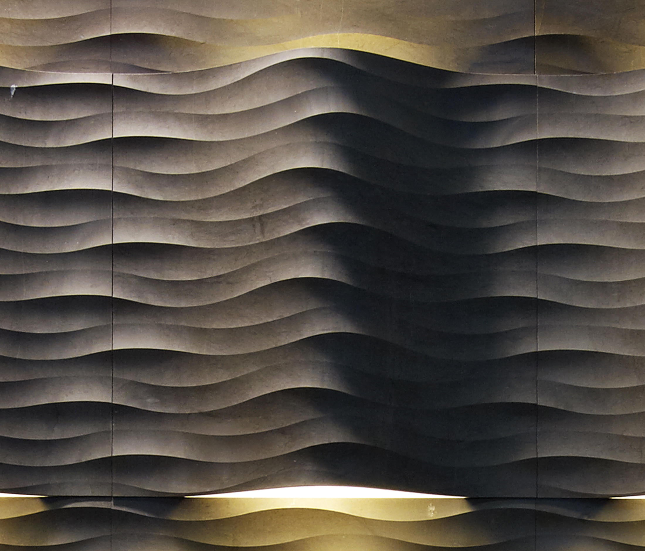 Le pietre incise fondo curve luce natural stone panels for Curved wall