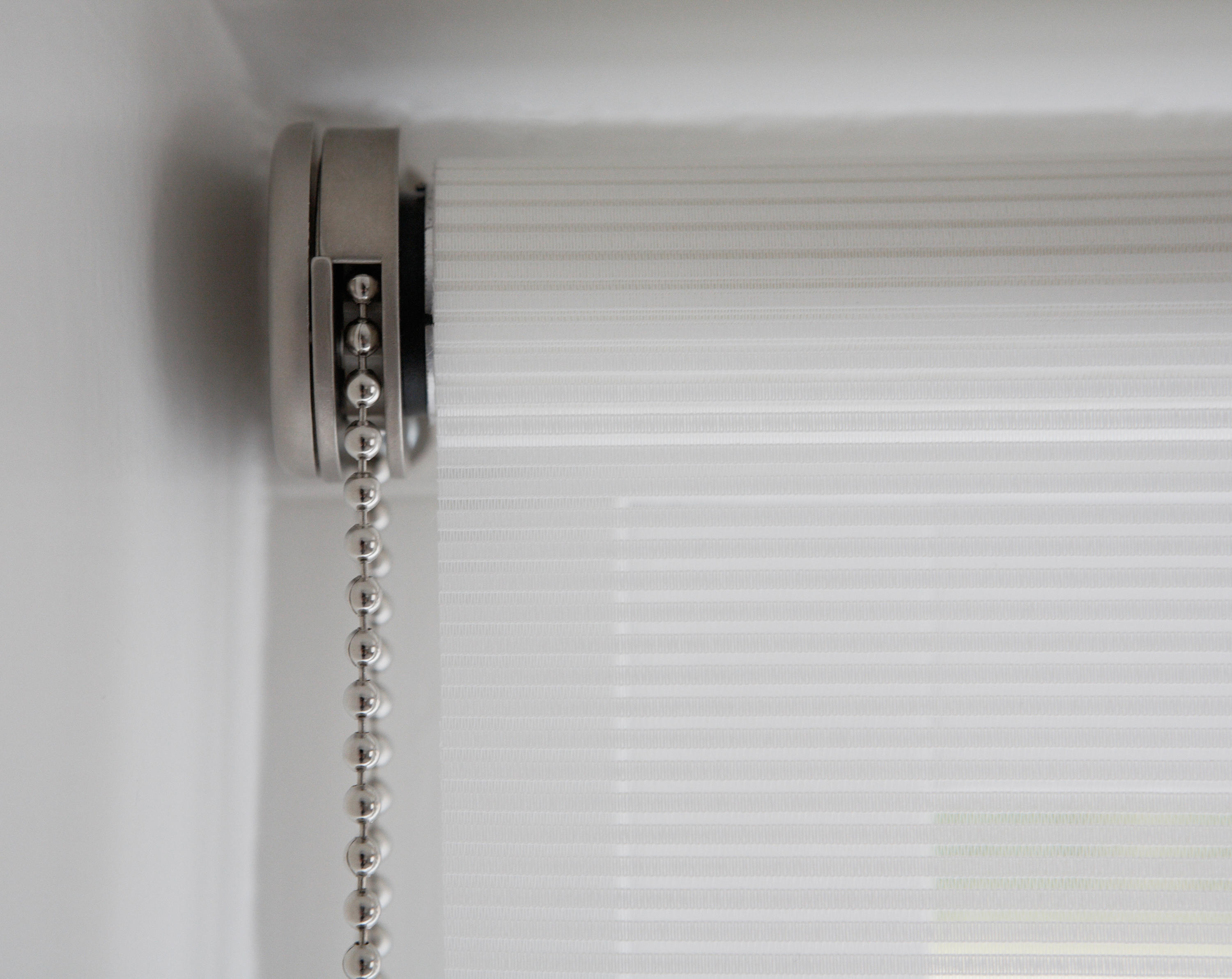 Chain command roller blinds cord operated systems from for Exterior no chain window shade