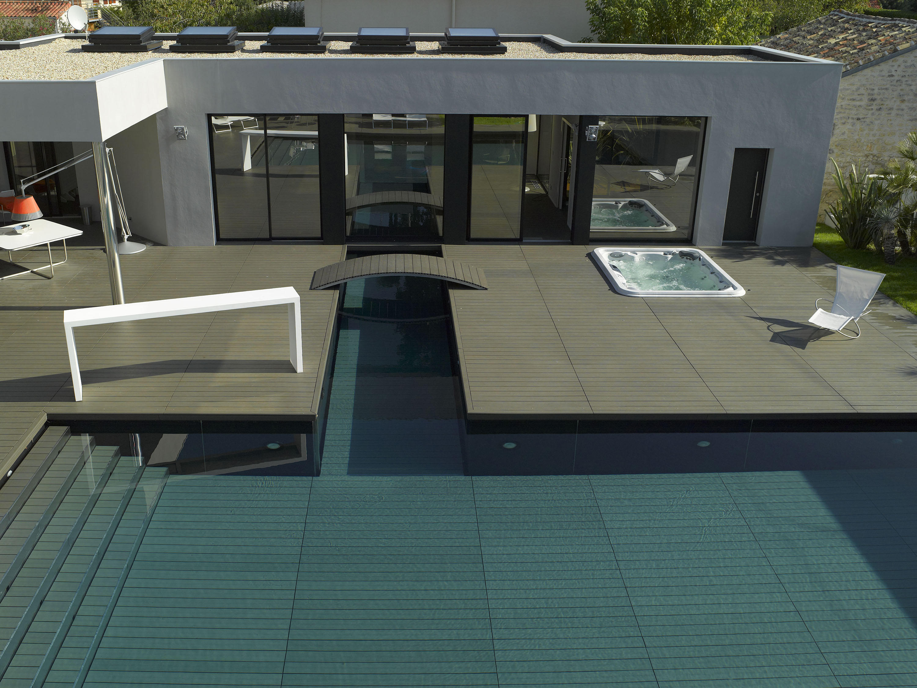 INDOOR-OUTDOOR POOL - Swimming pools from Piscines Carré Bleu ...