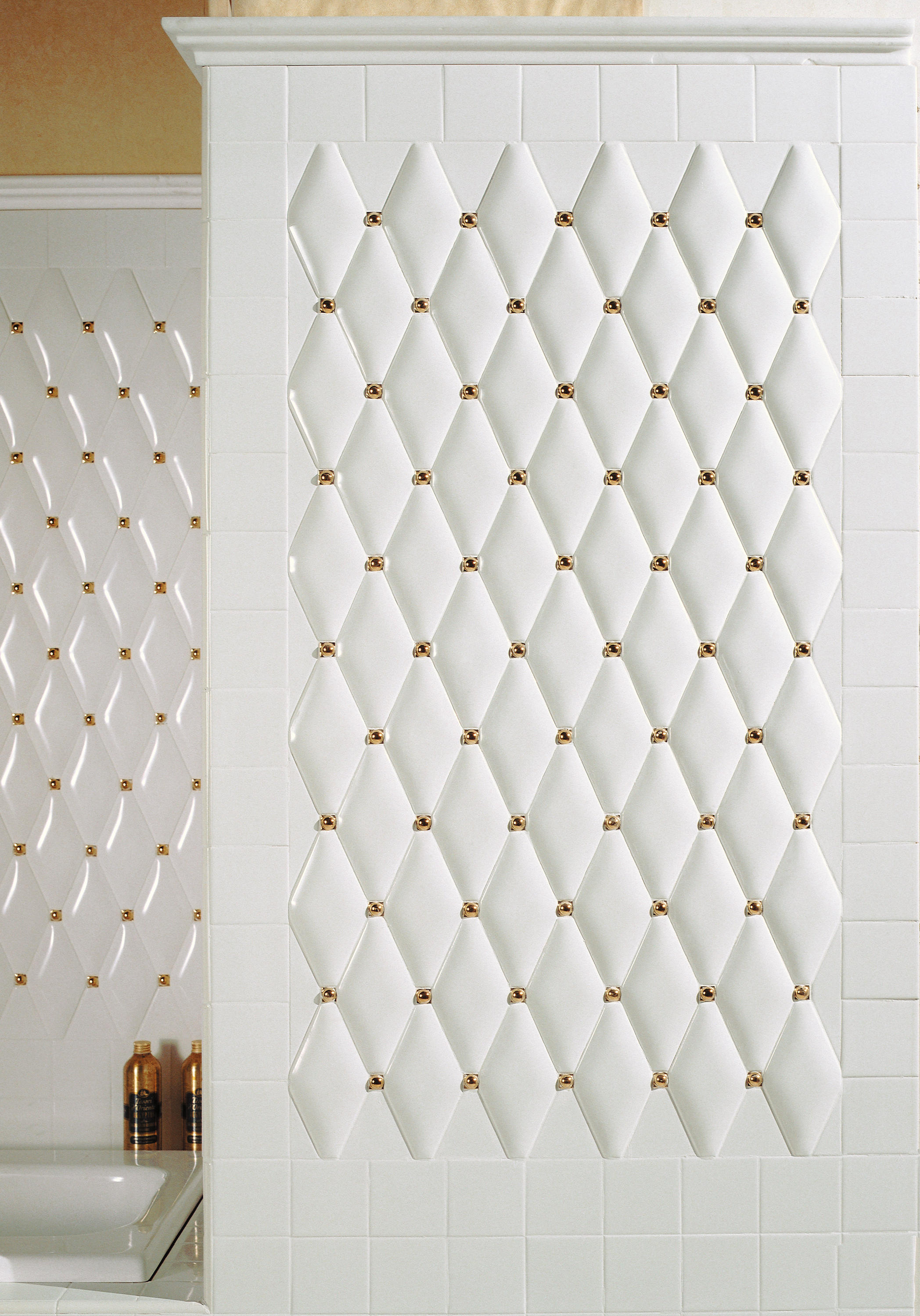 capitonn white rounded with gold inset ceramic tiles. Black Bedroom Furniture Sets. Home Design Ideas