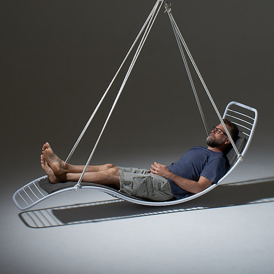 Curve Wave Lounger Swing Chair on Base stand by Studio Stirling