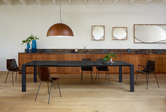 Naïa | Extending Dining Table Walnut Legs In Black Stained Oak by Ligne Roset