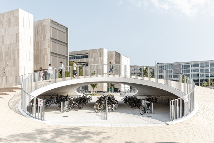 Bicycle parking under the hills by COBE | Industrial buildings