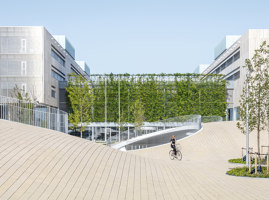 Bicycle parking under the hills | Construcciones Industriales | COBE