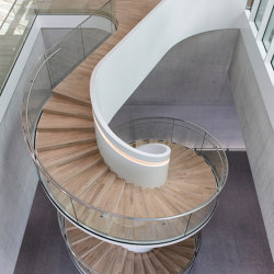 Staircase with elegant glass railings at the Bühler Innovation Campus in Uzwil | Scale | MetallArt Treppen