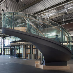 Design stairs featuring glass railings at Daimler in Sindelfingen | Scale | MetallArt Treppen