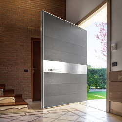 Synua | The safety door for large dimensions, with vertical pivot operation and installation coplanar with the wall. | Entrance doors | Oikos – Architetture d'ingresso