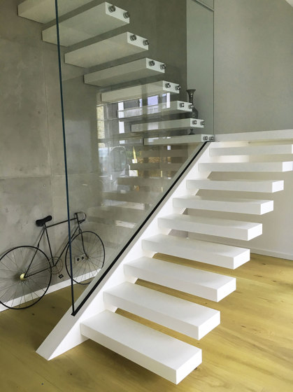 Floating stairs in Corian by Siller Treppen