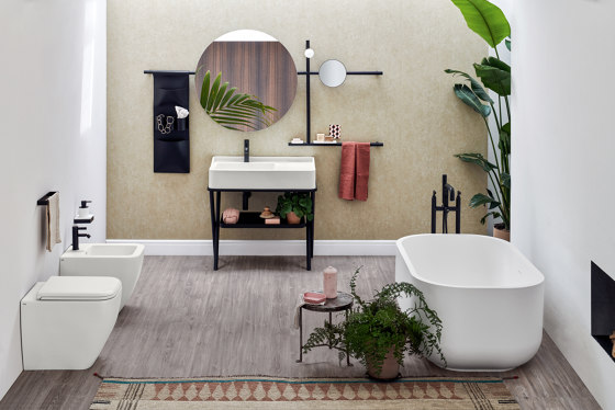 Siwa washbasin on structure | round mirror by Ceramica Cielo | Wash basins