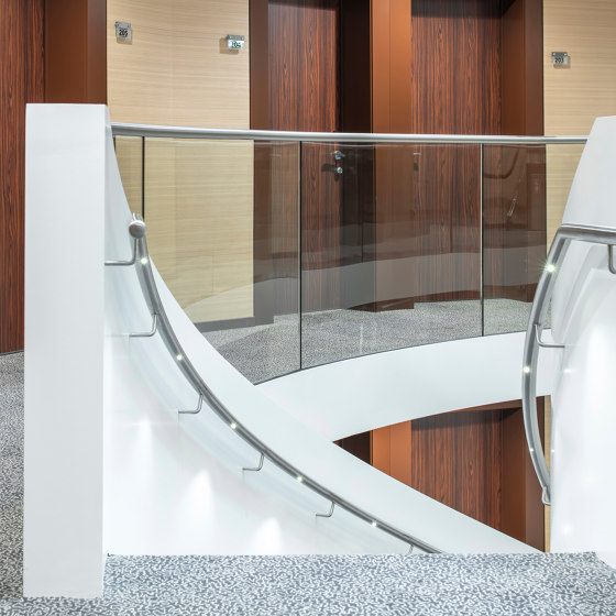 LED handrail lighting in noble finish at Nash Suites Airport Hotel in Meyrin by MetallArt Treppen | Staircase systems