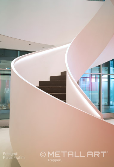 Sculptural stairs with indirect lighting at Hypovereinsbank in Hamburg by MetallArt Treppen | Staircase systems