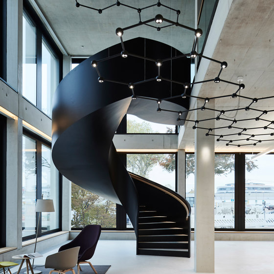 Expressive staircase sculpture at EVF in Göppingen by MetallArt Treppen | Staircase systems