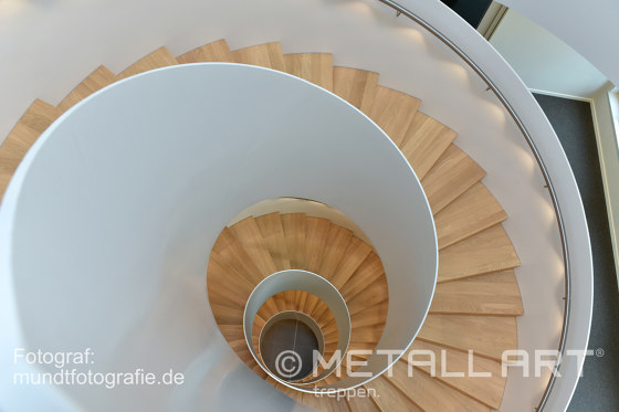 Impressively rounded stringer stairs with LED lighting at Norderstedt Bank by MetallArt Treppen | Staircase systems
