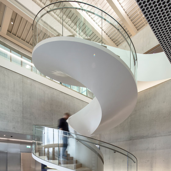 Staircase with elegant glass railings at the Bühler Innovation Campus in Uzwil by MetallArt Treppen | Staircase systems